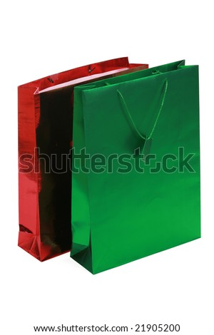 Red and green gift bags isolated on white