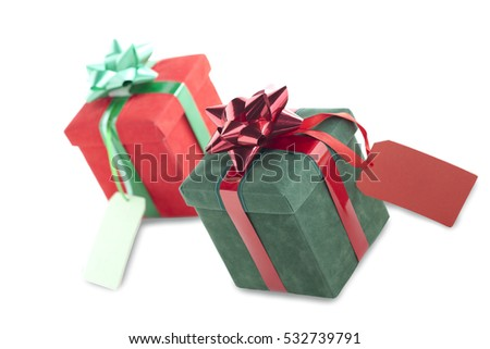 Red and green gift boxes present isolated on white background