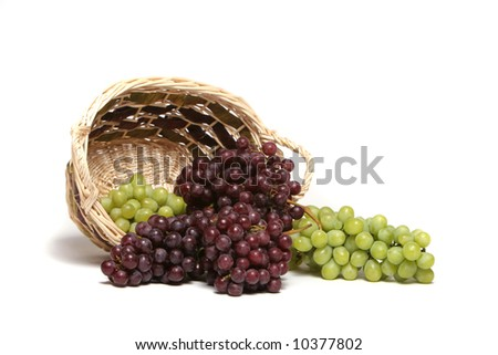 Red and green grapes in basket - stock photo