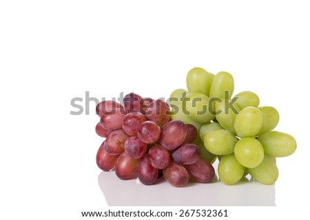 Red and Green Grapes Isolated on a White Background. Copy Space. - stock photo