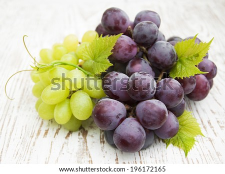 red and green  grapes on a wooden background - stock photo