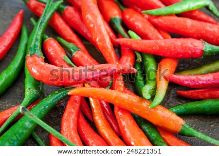 Red and green hot chili pepper, close up - stock photo