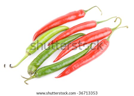 red and green hot chili peppers isolated on white