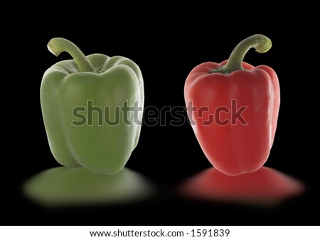 red and green pepper isolated on black