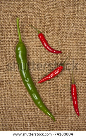 Red and green peppers on a piece of canvas