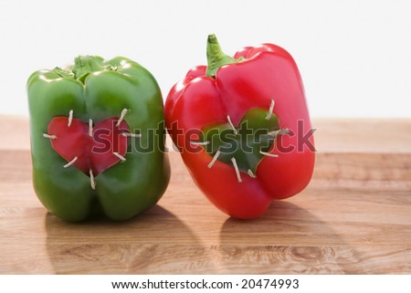 Red and Green Peppers with Hearts - stock photo