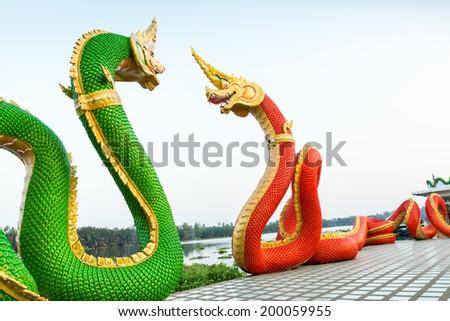 Red and green serpent statue at Wat Saman Rattana Ram Chachoengs - stock photo