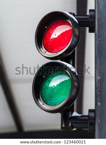 Red and green small round traffic light - stock photo