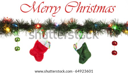 Red and Green Stockings with Candy Cane and Ornaments Hanging from LED Christmas Lights, Isolated, White - stock photo