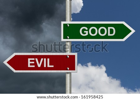 Red and green street signs with blue and stormy sky with words Good and Evil, Good versus Evil