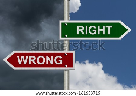 Red and green street signs with blue and stormy sky with words Right and Wrong, Right versus Wrong - stock photo