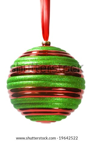 Red and green striped Christmas ornament hanging from red ribbon, isolated on white background (with clipping path). - stock photo
