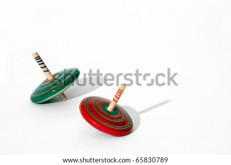 red and green top toys on white background, old style game