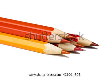 Red and orange pencils isolated on white background.Close up. - stock photo