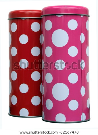 Red and pink kitchen cans with white spots. Red and pink cans with spots. - stock photo