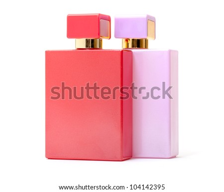 Red and Pink Perfume Bottles on white background - stock photo