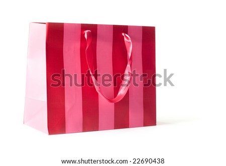 Red and pink striped retail bag isolated on white.