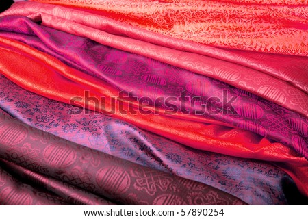 Red and purple silk fabric from India. - stock photo