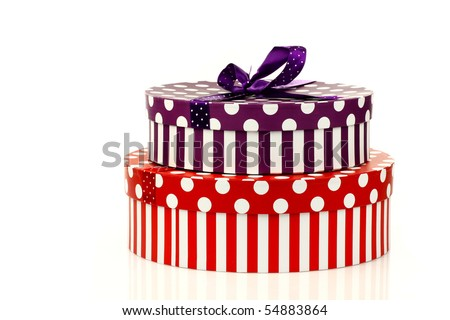 red and purple striped gift boxes on a white background - stock photo