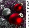Red and silver Christmas baubles border on fur - stock photo