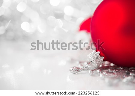 Red and silver xmas ornaments on bright holiday background. Merry christmas! - stock photo