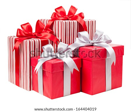 Red and striped boxes with gifts tied bows on white background - stock photo