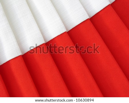 red and white abstract folded fabric background
