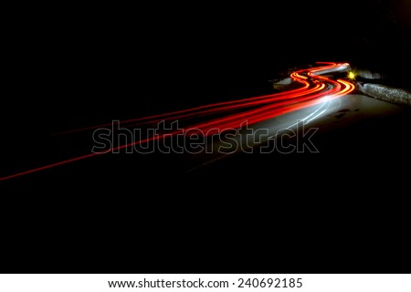 red and white Car light trails in the tunnel. Art image . Long exposure photo taken in a tunnel  - stock photo
