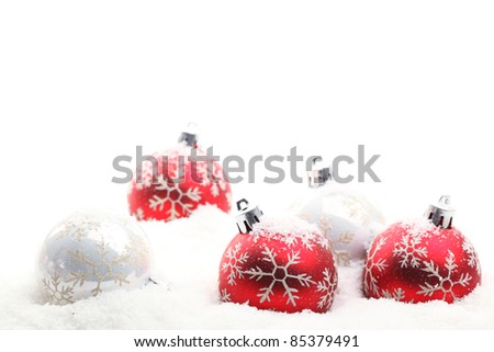 Red and white christmas balls in snow flakes,Shallow Dof. - stock photo
