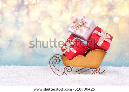 red and White Christmas gift boxes decorated in a sleigh, Christmas gift