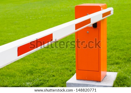 Red and white closed barrier in the park - stock photo