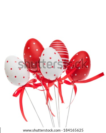 red and white decorative easter eggs with ribbons, isolated - stock photo
