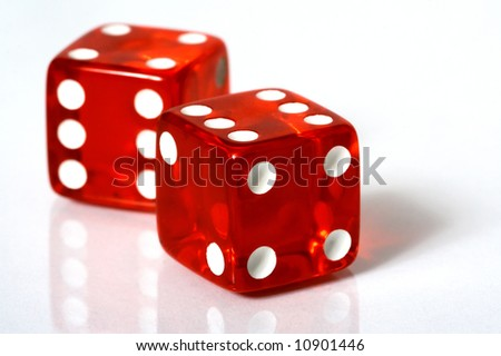 Red and white dice on a white background