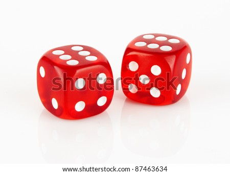 Red and white dices on a white background - stock photo