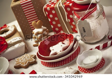 Red and white dishware and gingerbread cookies