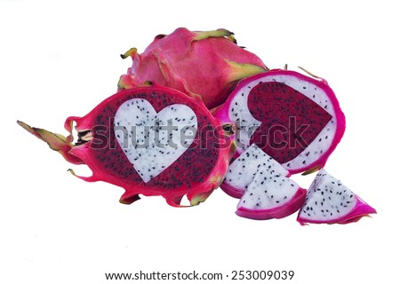 Red and white dragon fruit insert heart shape isolated - stock photo