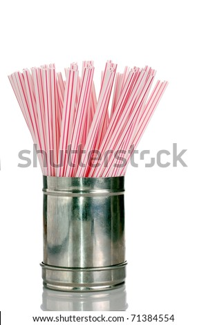 Red and White Drinking Straws in a Straw Stainless Steel Dispenser - stock photo