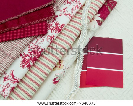Red and white fabric and paint swatches - stock photo