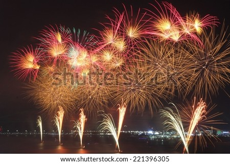 Red and white fireworks demonstrating celebration, pyrotechnics and color - stock photo