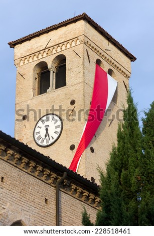 Red and White Flag Hanging from a Church Bell Tower - stock photo