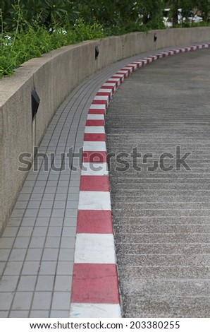 Red and white footpath  - stock photo