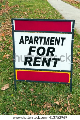 Red and White For Rent Sign on Lawn - stock photo