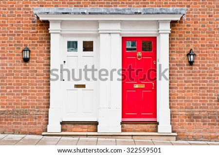 Red and white front doors in adjoining town houses - stock photo
