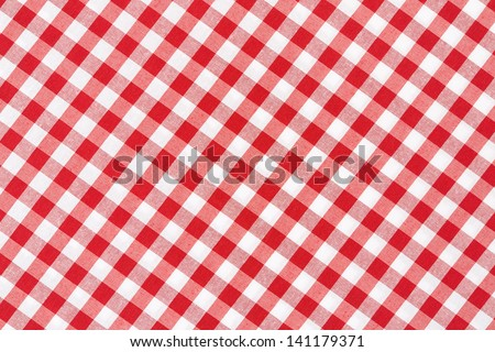 Red and white gingham diagonal tablecloth texture background - stock photo