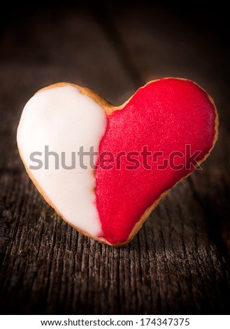 Red and white heart shape cookies on the wooden background  - stock photo