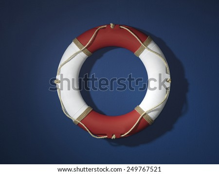 Red and White Life ring on Blue wall - stock photo