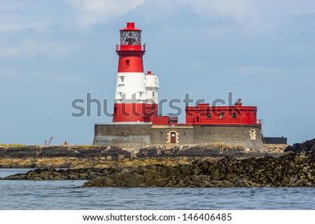 Red And White Longstone Lighthouse  - stock photo