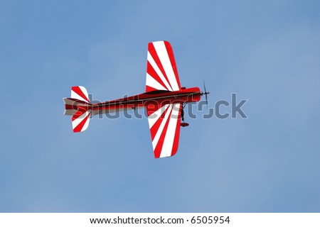 Red and white model airplane - stock photo