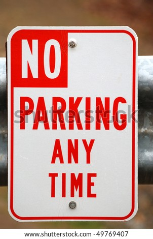 Red and white No Parking Any Time sign on a gate - stock photo