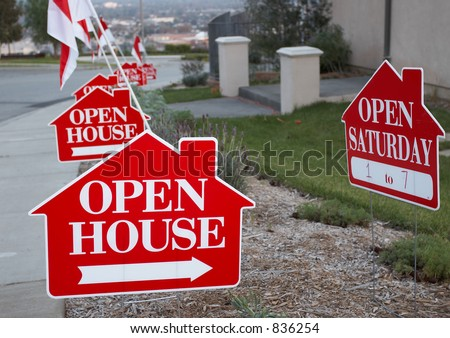 Red and white open house sign close-up with more signs in the background - stock photo
